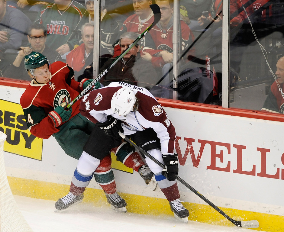. ST PAUL, MN - JANUARY 19:  Ryan Wilson #44 of the Colorado Avalanche checks Mikael Granlund #64 of the Minnesota Wild into the boards during the first period of the game on January 19, 2013 at Xcel Energy Center in St Paul, Minnesota. (Photo by Hannah Foslien/Getty Images)