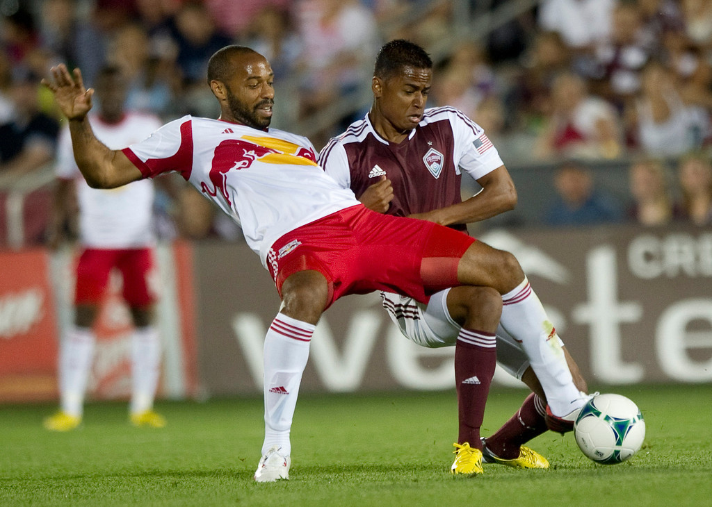 . DENVER - JULY 4: Jaime Castrillon, #23 of the Colorado Rapids, wrestles with #14 Thierry Henry of the New York Red Bulls during the second half of a MLS soccer match against the on July 4, 2013 at Dick\'s Sporting Goods Park. The Rapids defeated the Red Bulls 2-0.(Photo By Grant Hindsley / The Denver Post)