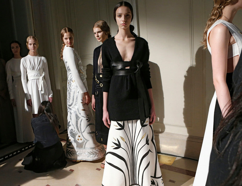 . Models wait backstage prior to the Valentino Fall Winter 2014-15 Haute Couture fashion collection, presented in Paris, Wednesday, July 9, 2014. (AP Photo/Jacques Brinon)