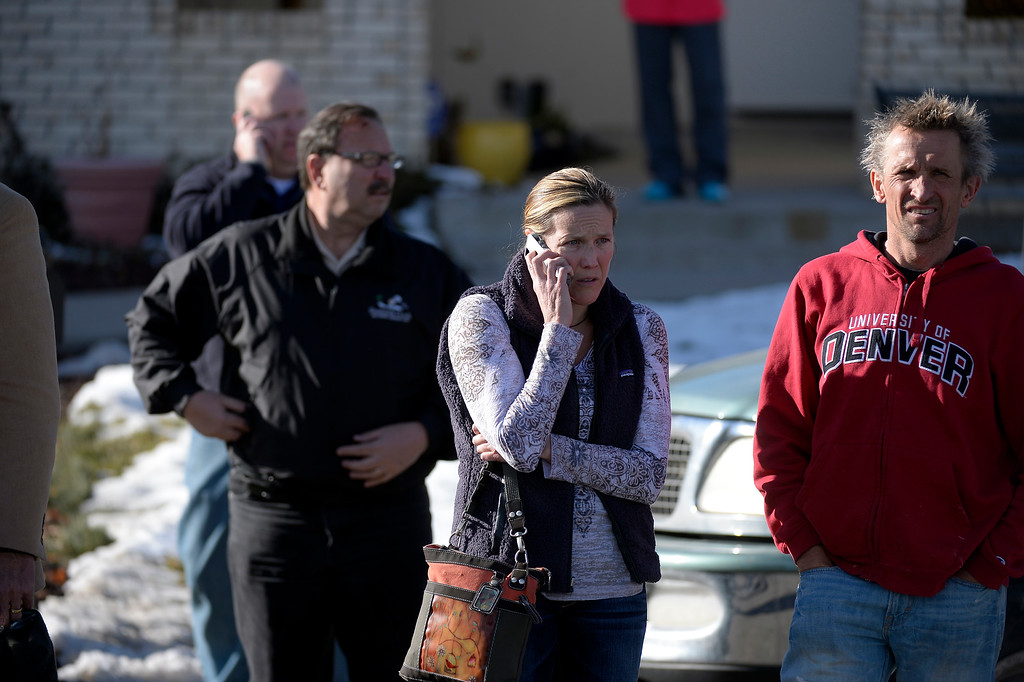 . CENTENNIAL, CO - Arapahoe High School parents on the phones trying to get in contact with their son or daughter as they stand on the street near the tennis courts. The students were taken to the football field for safety. A gunman was spotted inside Arapahoe High School December 13, 2013. The gunman was targeting a teacher at the school. The gunman shot two students in the process and then turned the gun on himself. DECEMBER 13:  (John Leyba, The Denver Post)