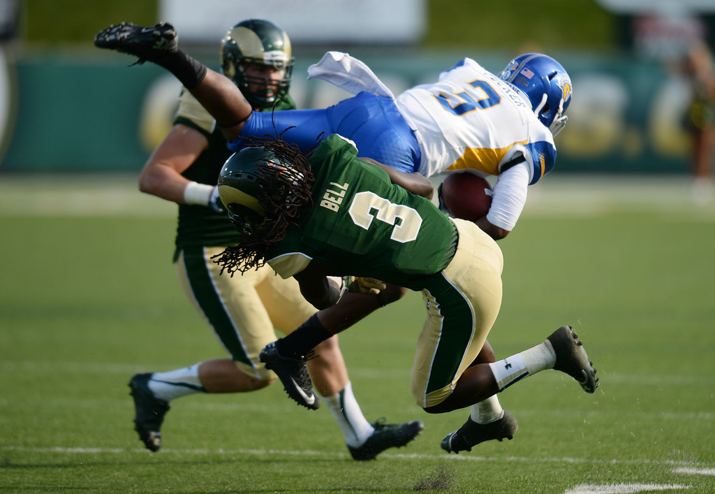 . FORT COLLINS, CO - OCTOBER 12 : Shaq Bell of Colorado State (3), front, tackles Thomas Tucker of San Jose State (3) in the 3rd quarter of the game at Hughes Stadium. Fort Collins. Colorado. October 12, 2013. Tucker was injured in the play. San Jose won 34-27. (Photo by Hyoung Chang/The Denver Post)