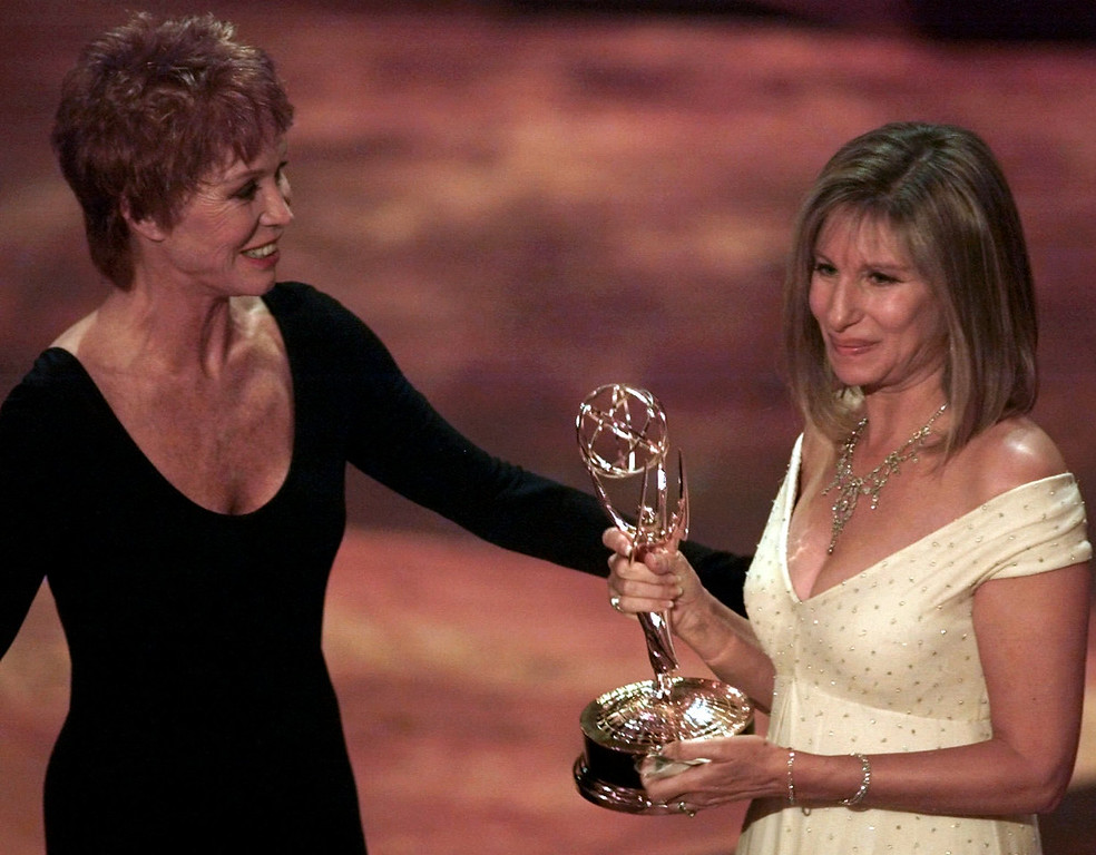 ". Mary Tyler Moore, left, presents Barbra Streisand with the Emmy for Outstanding Individual Performance in a Variety or Music Program for Streisand\'s appearance in ""Barbra Streisand The Concert\"" during the 47th annual Emmy Awards, Sunday, Sept. 10, 1995, in Pasadena, Calif. (AP Photo/Eric Draper)"