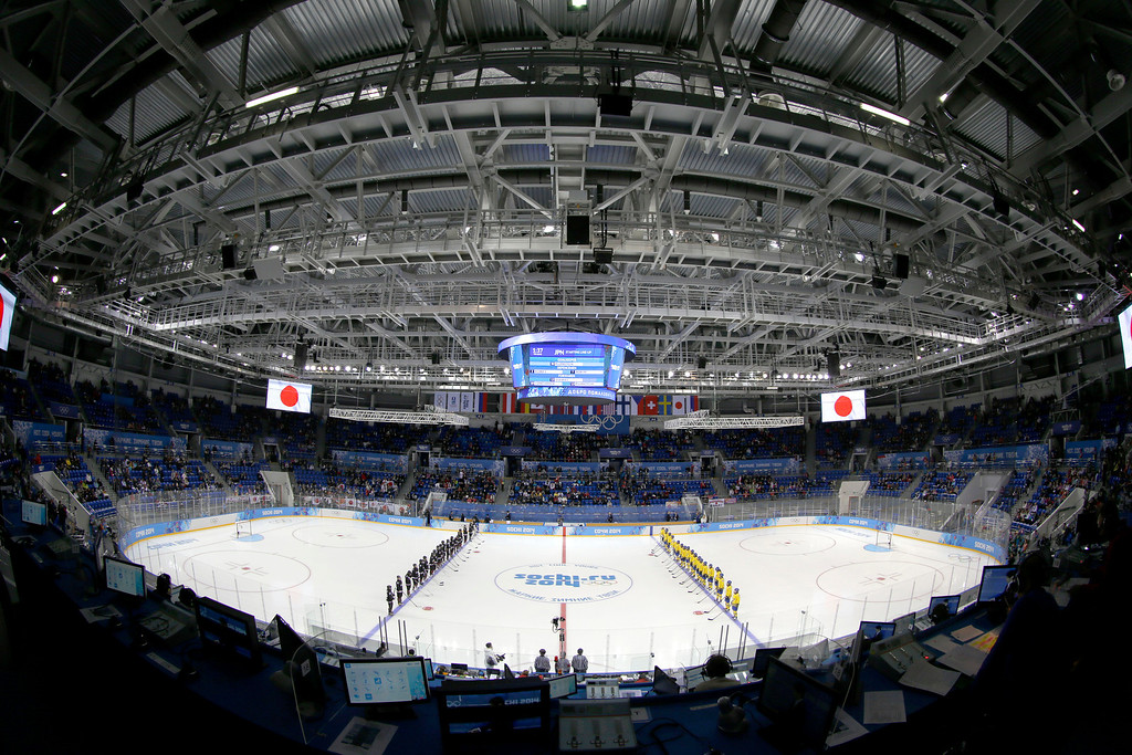 . Team Japan, left and Team Sweden line up before their women\'s ice hockey game at Shayba Arena during the 2014 Winter Olympics, Sunday, Feb. 9, 2014, in Sochi, Russia. (AP Photo/Matt Slocum)