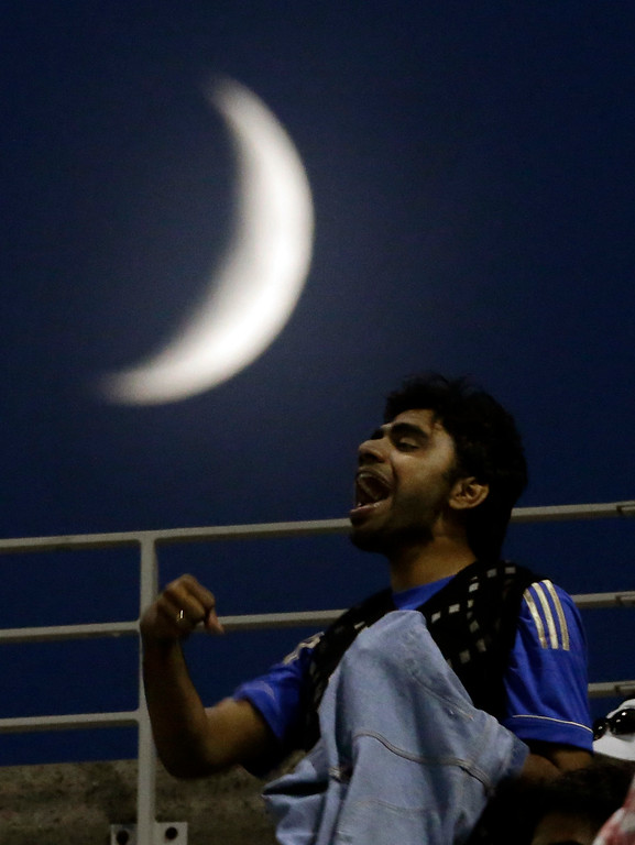 . A spectator cheers while watching play between Rafael Nadal, of Spain, and Novak Djokovic, of Serbia, during the men\'s singles final of the 2013 U.S. Open tennis tournament, Monday, Sept. 9, 2013, in New York. (AP Photo/Julio Cortez)