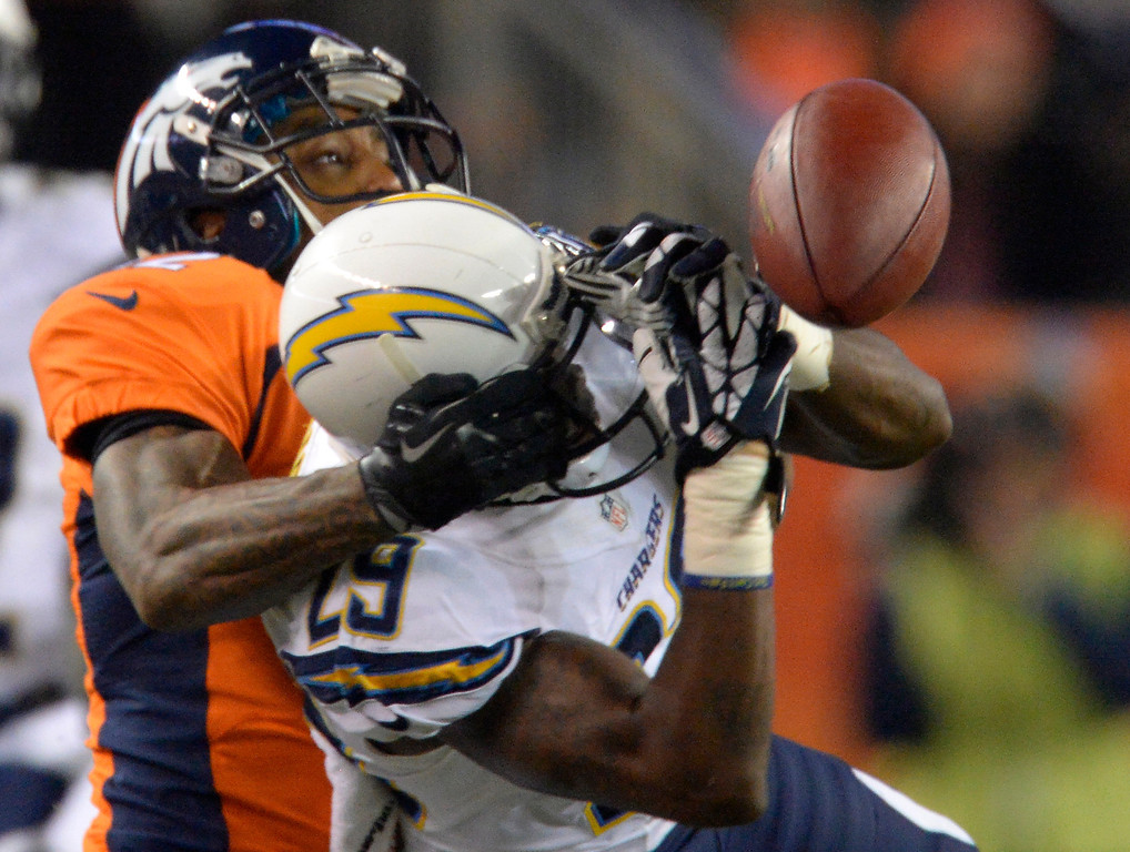 . San Diego Chargers cornerback Shareece Wright (29) has a near interception broken up by Denver Broncos wide receiver Andre Caldwell (12) the intended receiver during the second quarter. The Denver Broncos vs. the San Diego Chargers at Sports Authority Field at Mile High in Denver on December 12, 2013. (Photo by John Leyba/The Denver Post)