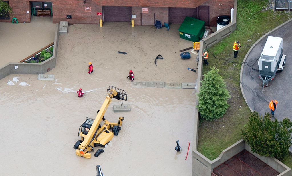 . This aerial photo shows flood waters surrounding the hospital in Canmore, Alberta, Canada, on Friday June 21, 2013.   (AP Photo/The Canadian Press, Jonathan Hayward)