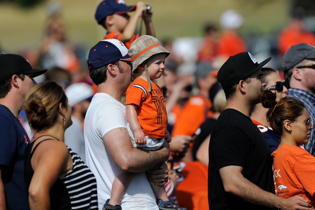 . ENGLEWOOD, CO - JULY 27: Denver Broncos fans get a peek at the action during training camp at Dove Valley Saturday July 26, 2013.  (Photo By Andy Cross/The Denver Post)