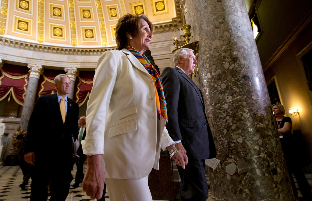 . House Minority Whip Rep. Steny Hoyer, D-Md., right, and House Minority Leader Rep. Nancy Pelosi, D-Calif., center, walk through Statuary Hall on Capitol Hill, in Washington, Monday, Sept. 30, 2013. Republicans and Democrats blamed each other Monday as they took the federal government to the brink of a shutdown in an intractable budget dispute over President Barack Obama\'s signature health care law.   (AP Photo/Manuel Balce Ceneta)