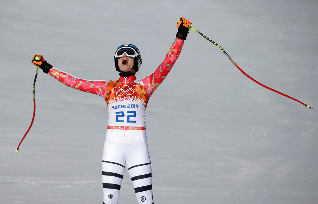 . Germany\'s Maria Hoefl-Riesch celebrates after finishing the women\'s super-G at the Sochi 2014 Winter Olympics, Saturday, Feb. 15, 2014, in Krasnaya Polyana, Russia. (AP Photo/Gero Breloer)
