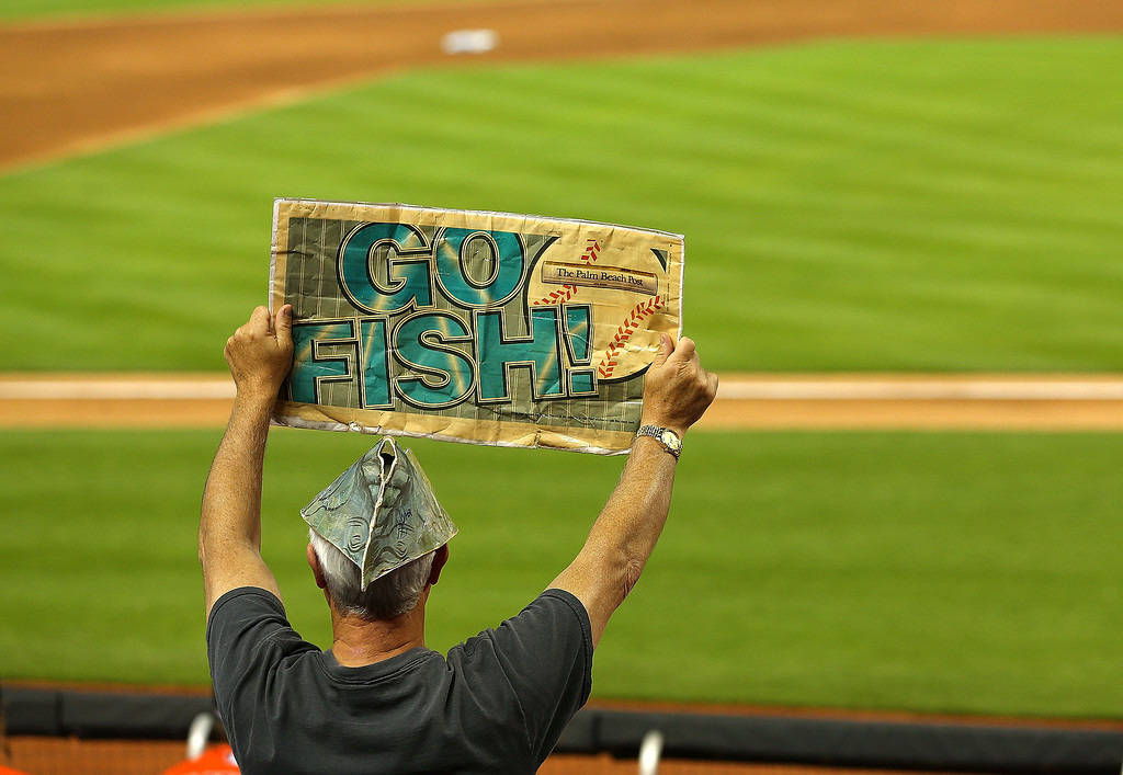 . A Miami Marlins fan watches Opening Day against the Colorado Rockies at Marlins Park on March 31, 2014 in Miami, Florida.  (Photo by Mike Ehrmann/Getty Images)