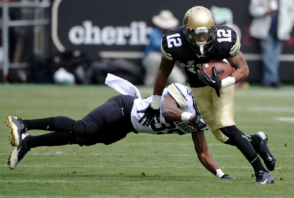 . BOULDER, CO.- APRIL13: Keenan Canty out maneuvers Brandan Brisco and makes his way down field. The University of Colorado football team hosts its spring football game at Folsom Field under the direction of new head coach Mike MacIntyre. (Photo By Kathryn Scott Osler/The Denver Post)