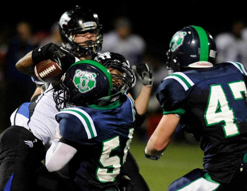 . HIGHLANDS RANCH, CO. - SEPTEMBER 13: Grizzlies\' linebacker Tyler Seno (54) brought down Wolves\' senior wide receiver Isaiah Lang (6) when Grandview attempted a reverse in the second half. The ThunderRidge High School football team defeated Grandview 21-7 at Shea Stadium Friday night, September 13, 2013.  Photo By Karl Gehring/The Denver Post
