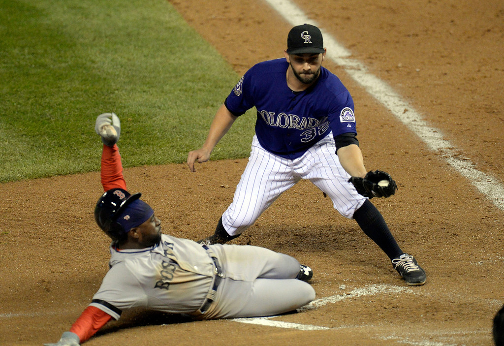 . DENVER, CO. - SEPTEMBER 24: Tyler Chatwood (32) of the Colorado Rockies tags out Jackie Bradley Jr. (25) of the Boston Red Sox at home plate for he out in the 7th inning September 24, 2013 at Coors Field. (Photo by John Leyba/The Denver Post)