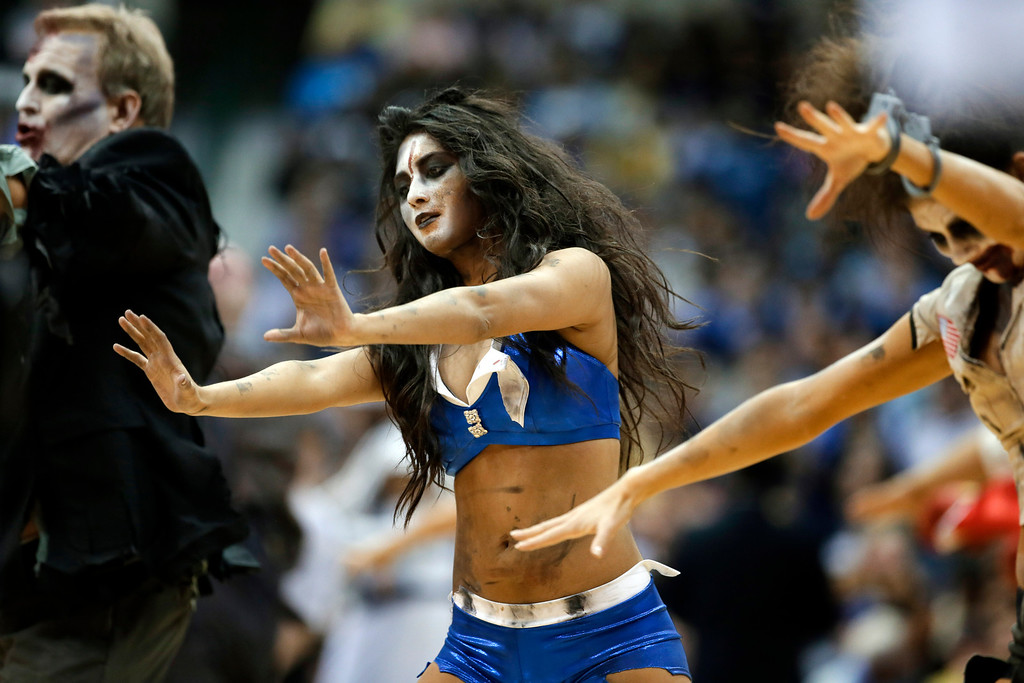 ". Members of the Dallas Mavericks dancers and Mav Maniacs perform in zombie style costumes to the song ""Thriller\"" by Michael Jackson during an official time out in the second half of an NBA basketball game between the Atlanta Hawks and the Mavericks, Wednesday, Oct. 30, 2013, in Dallas. The Mavericks won 118-109. (AP Photo/Tony Gutierrez)"
