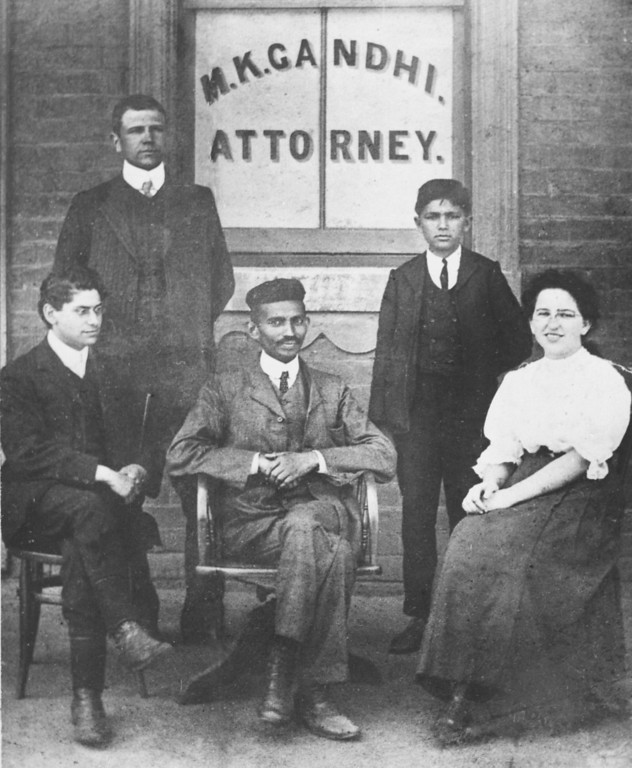 . Mohandas K. Gandhi, center seated, is surrounded by workers in his law office in Johannesburg, South Africa, in 1902.  Gandhi, the country\'s first lawyer who is a person of color to be admitted to the bar, spent most of his 20 years in South Africa protesting the treatment of Indians by the British.  The others in the photo are not identified.  (AP Photo)