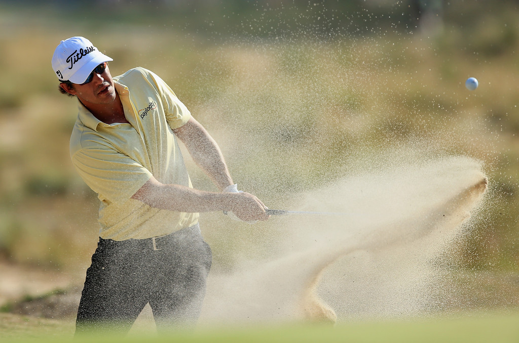 . Brooks Koepka of the United States hits a shot from a greenside bunker on the 12th hole during the final round of the 114th U.S. Open at Pinehurst Resort & Country Club, Course No. 2 on June 15, 2014 in Pinehurst, North Carolina.  (Photo by David Cannon/Getty Images)