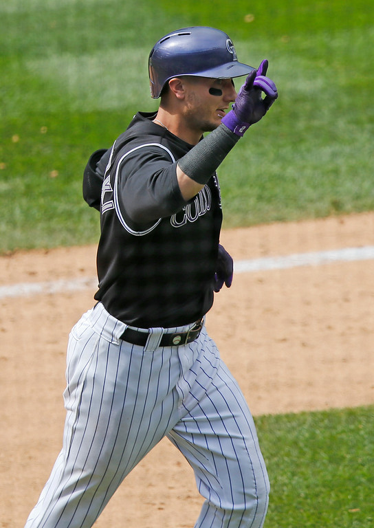 . Colorado Rockies\' Troy Tulowitzki celebrates his second home run of the day against the San Diego Padres during the eighth inning of a baseball game on Wednesday, July 9, 2014, in Denver. (AP Photo/Jack Dempsey)