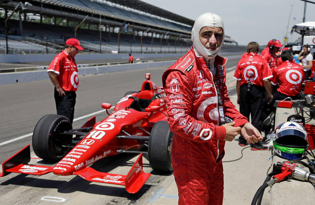 . Dario Franchitti, of Scotland, prepares to drive during practice for the Indianapolis 500 auto race at the Indianapolis Motor Speedway in Indianapolis, Wednesday, May 15, 2013. (AP Photo/Michael Conroy)