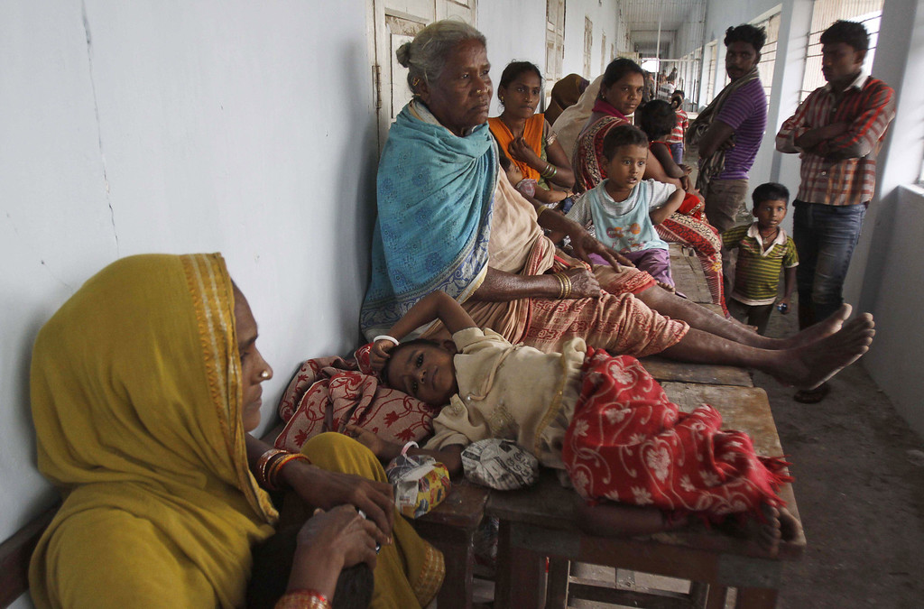 . Evacuated Indian villagers take refuge in a temporary cyclone shelter in  Chatrapur , in Ganjam district about 200 kilometers  (125 miles) from the eastern Indian city Bhubaneswar, India, Saturday, Oct. 12, 2013. Strong winds and heavy rains pounded India\'s eastern coastline Saturday, as hundreds of thousands of people took shelter from a massive, powerful Cyclone Phailin expected to reach land in a few hours. (AP Photo/Biswaranjan Rout)