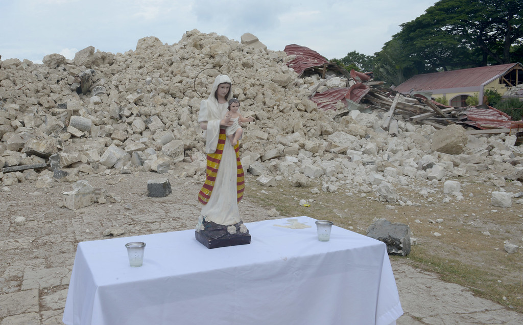. A makeshift altar is put before the ruins of the 180 years old Our lady of light Church on the popular tourist island of Bohol, central Philippines on October 16, 2013 following a 7.1-magnitude earthquake in the area on October 15.  AFP PHOTO / Jay DIRECTO/AFP/Getty Images