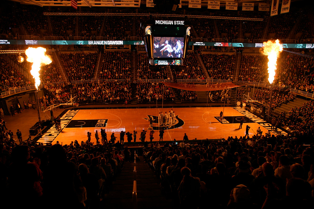 . Pyrotechnics illuminate the Breslin Center as Michigan State players are introduced before an NCAA college basketball scrimmage, Friday, Oct. 18, 2013, in East Lansing, Mich. (AP Photo/Al Goldis)