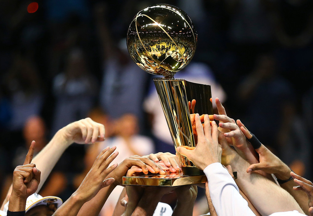 . The San Antonio Spurs celebrate with the Larry O\'Brien trophy after defeating the Miami Heat to win the 2014 NBA Finals at the AT&T Center on June 15, 2014 in San Antonio, Texas.   (Photo by Andy Lyons/Getty Images)