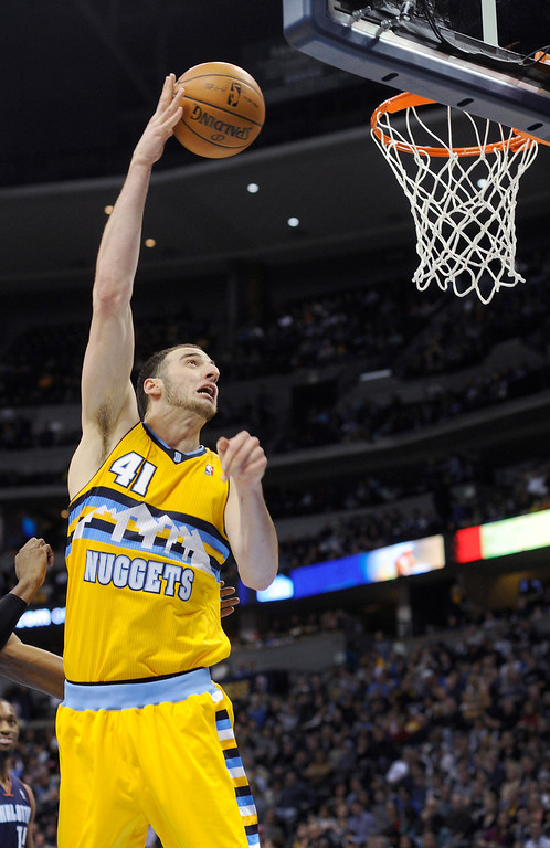 . Denver center Kosta Koufos hooks shot into the net in the second half of the Nuggets\' game against the Charlotte Bobcats at the Pepsi Center.   Karl Gehring/The Denver Post