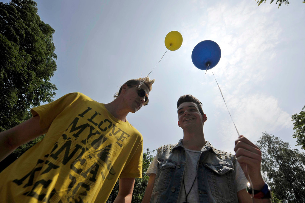 . People participate in a Gay Pride Parade in Ljubljana June 15, 2013. About 600 participants took part in the parade. REUTERS/Srdjan Zivulovic