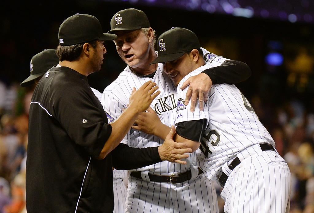. DENVER, CO. - June 28: From right, pitcher Jhoulys Chacin (45), pitching coach Jim Wright (52) and special assistant coach Vinny Castilla (9) of Colorado Rockies celebrate winning of the game against San Francisco Giants at Coors Field. Denver, Colorado. June 28, 2013. Colorado won 4-1. (Photo By Hyoung Chang/The Denver Post)