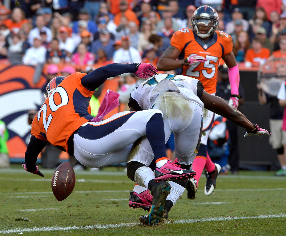 . Denver Broncos strong safety Mike Adams #20 breaks up a pass to Jacksonville Jaguars wide receiver Justin Blackmon #14 at the goal line late in the 4th quarter at Sports Authority Field at Mile High. August 13, 2013 Denver, October. (Photo By Joe Amon/The Denver Post)