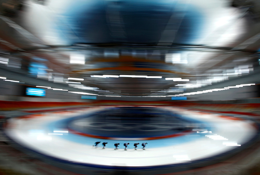 . In this picture made with a fisheye lens, South Korean speedskaters practice at the 2014 Winter Olympics in Sochi, Russia, Thursday, Feb. 20, 2014. (AP Photo/Patrick Semansky)