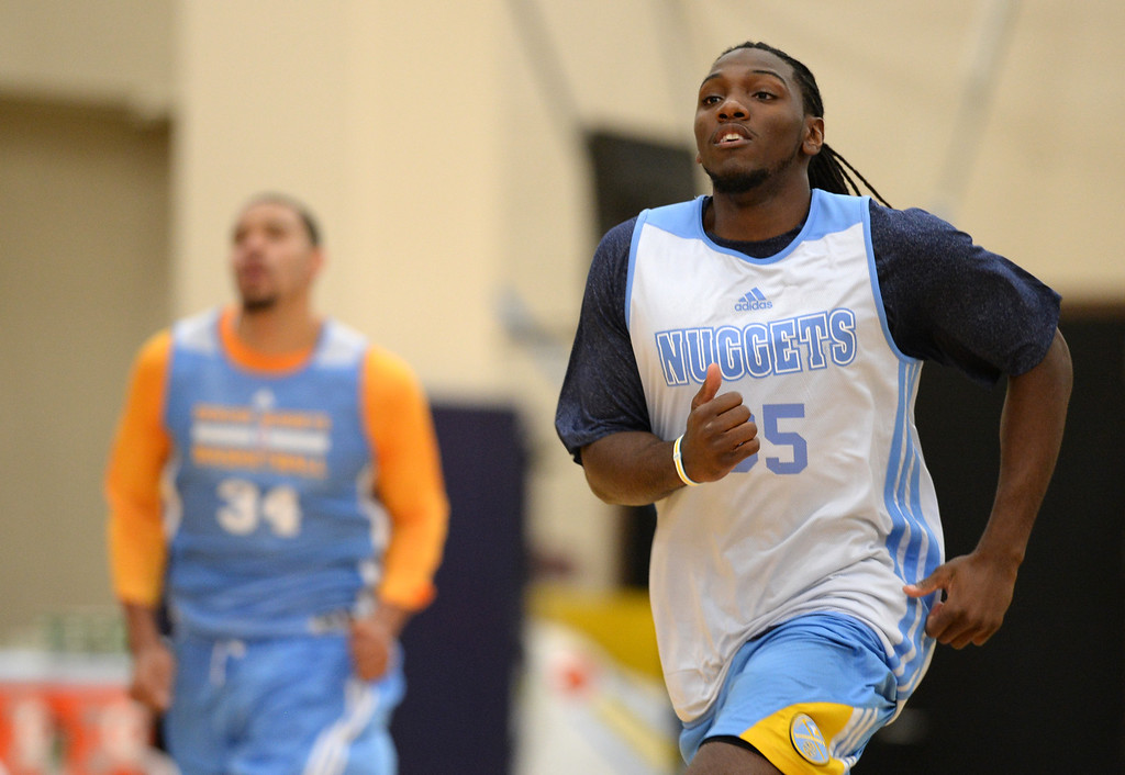 . Kenneth Faried (35) and Denver Nuggets take the court for their first official practice under new coach Brian Shaw at Pepsi Center. Denver, Colorado. October 1, 2013. (Photo by Hyoung Chang/The Denver Post)