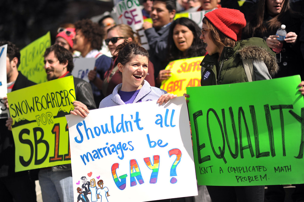 . DENVER, CO. - FEBRUARY 28:Talitha Koehler, 27, of Denver, front left, Whitney Shook, 25, of Denver right, and supporters of Colorado Civil Union Act gather in front of Colorado State Capitol building. February 28, 2013. Denver, Colorado. (Photo By Hyoung Chang/The Denver Post)