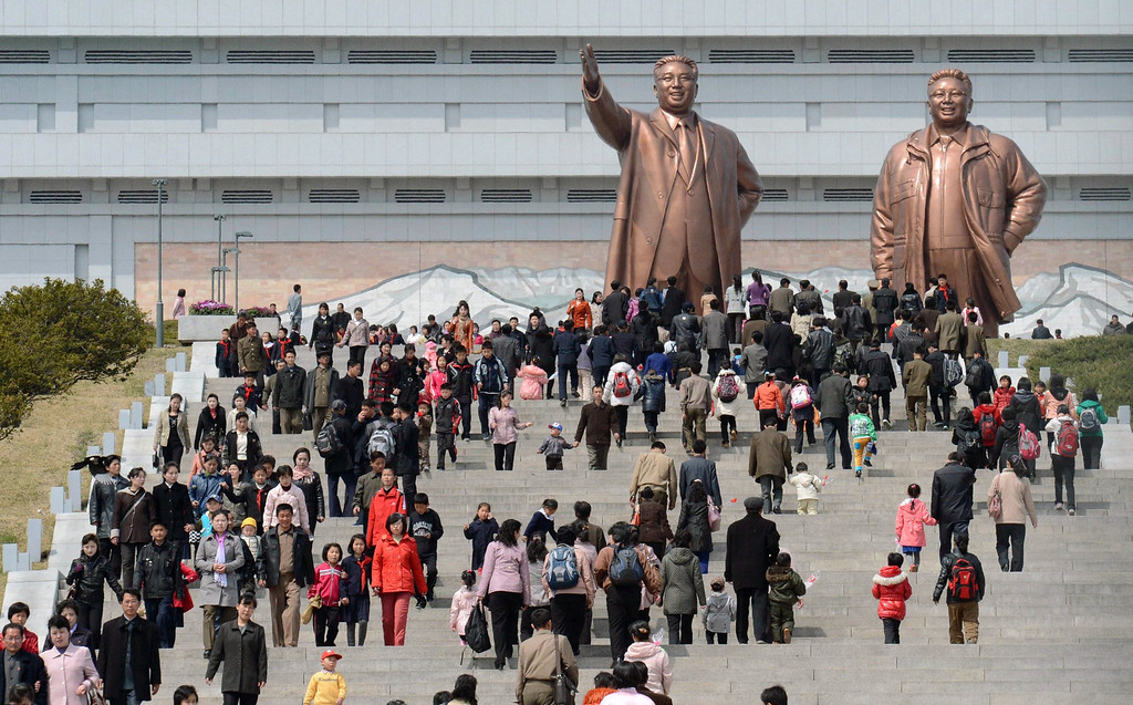 . People visit giant statues of the late North Korean leaders, Kim Il Sung, left, and his son Kim Jong Il, in Pyongyang, North Korea, Monday, April 15, 2013. Oblivious to international tensions over a possible North Korean missile launch, Pyongyang residents spilled into the streets Monday to celebrate a major national holiday, the birthday of their first leader, Kim Il Sung. (AP Photo/Kyodo News)