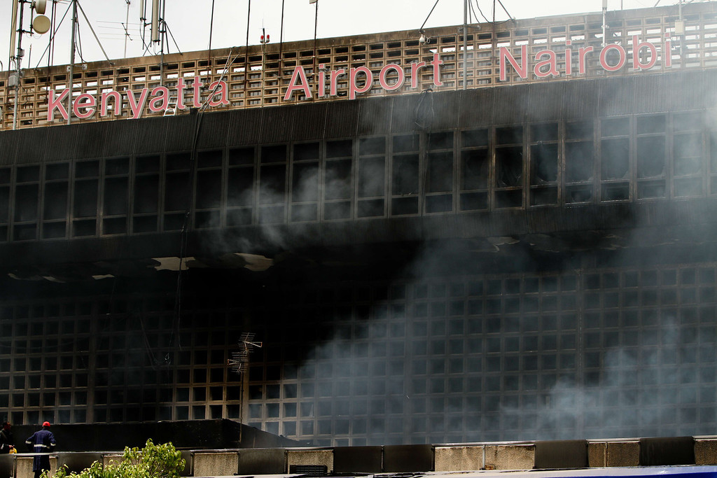 . The burnt exterior of the Jomo Kenyatta international airport is pictured in Nairobi on August 7, 2013.  AFP PHOTO/Lama  KABBANI/AFP/Getty Images