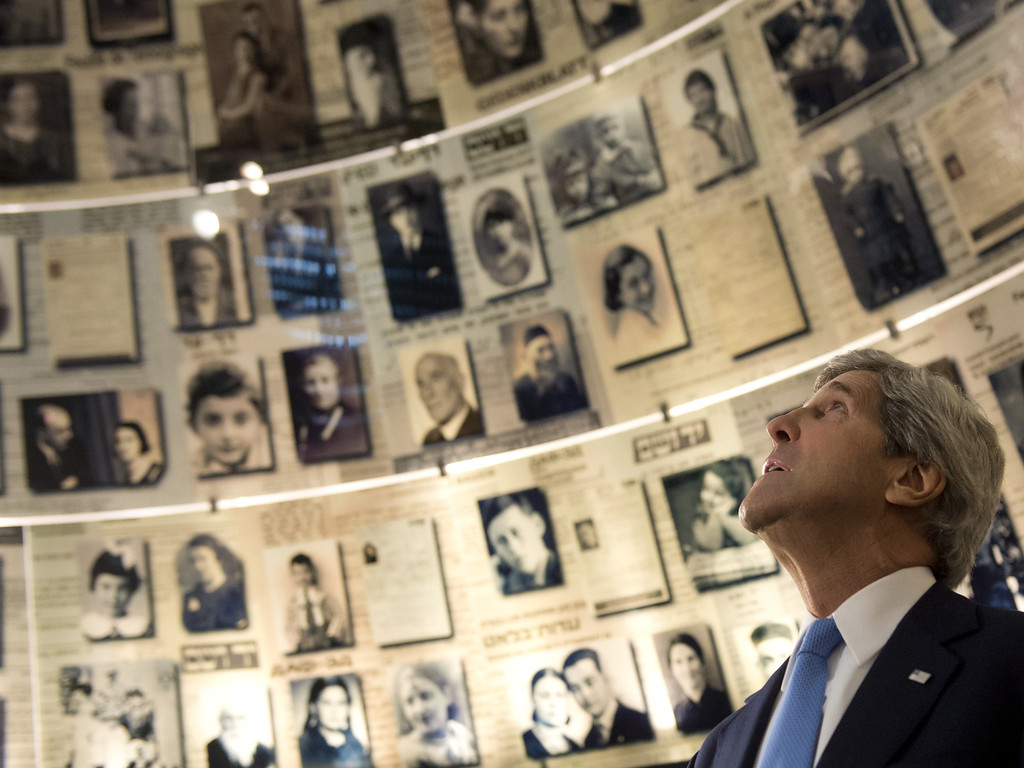 . US Secretary of State John Kerry tours the Hall of Names at the Yad Vashem Holocaust Museum in Jerusalem, which commemorates the six million Jewish Holocaust victims killed by the Nazis during World War II, March 22, 2013, on the final day of US President Barack Obama\'s 3-day trip to Israel and the Palestinian territories. AFP PHOTO / Saul LOEB/AFP/Getty Images