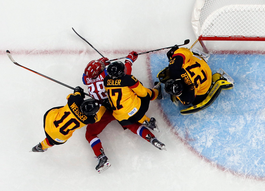 . German players Anja Weissner (L), Sara Seiler and goalkeeper Viona Harrer defend against Russia\'s Yekaterina Smolentseva during the women\'s match between Russia and Germany at the Shayba Arena in the Ice Hockey tournament at the Sochi 2014 Olympic Games, Sochi, Russia, 09 February 2014.  EPA/LARRY SMITH