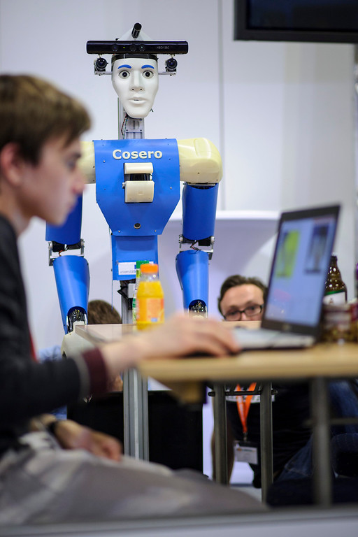 . Participants check a service robot at the 2014 RoboCup German Open tournament on April 03, 2014 in Magdeburg, Germany. 950 participants from 12 countries are participating in the the three-day tournament that compete in a variety of disciplines, including soccer, rescue and dance. (Photo by Jens Schlueter/Getty Images)
