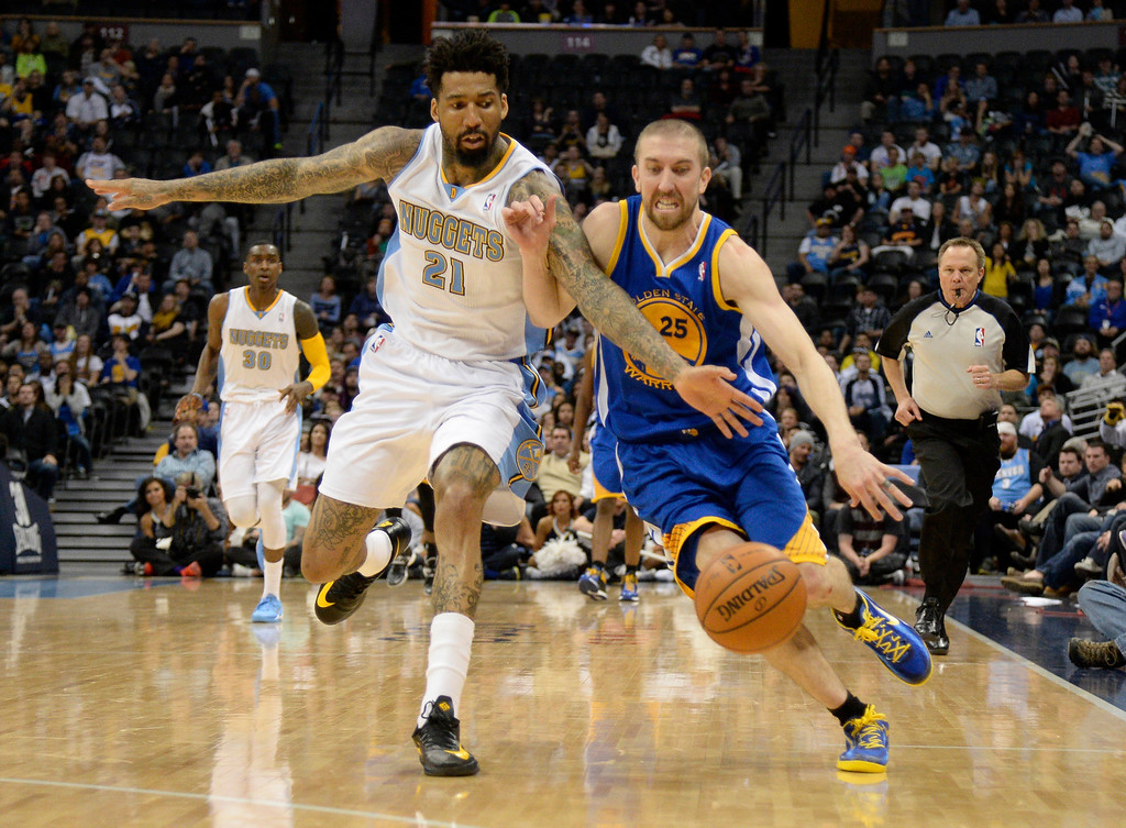 . DENVER, CO - APRIL 16: Denver Nuggets forward Wilson Chandler (21) reaches in on Golden State Warriors guard Steve Blake (25) for the ball during the fourth quarter April 16, 2014 at Pepsi Center. Golden State Warriors defeated the Denver Nuggets 116-112. (Photo by John Leyba/The Denver Post)