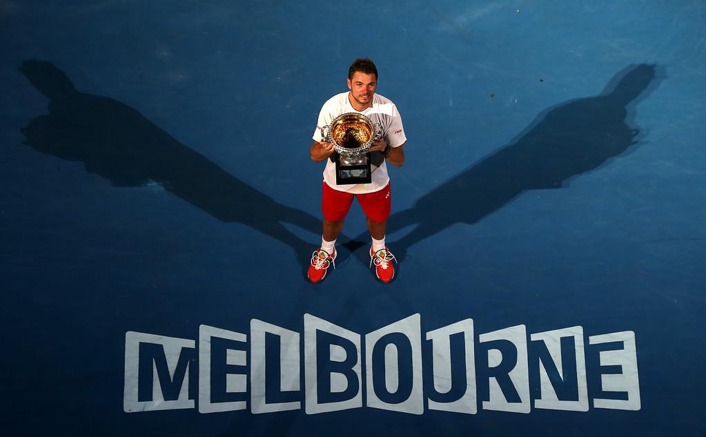 . Stanislas Wawrinka of Switzerland holds the trophy after defeating Rafael Nadal of Spain in the men\'s singles final at the Australian Open tennis championship in Melbourne, Australia, Sunday, Jan. 26, 2014.(AP Photo/Eugene Hoshiko)