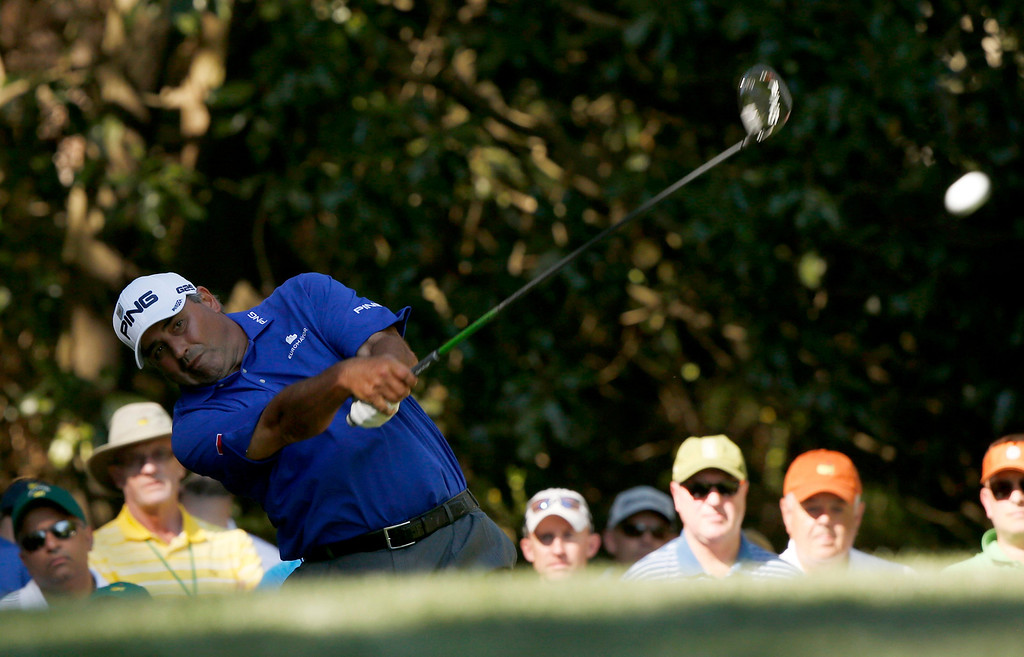 . Angel Cabrera of Argentina hits his tee shot on the 11th hole during third round play in the 2013 Masters golf tournament at the Augusta National Golf Club in Augusta, Georgia, April 13, 2013.   REUTERS/Mike Segar