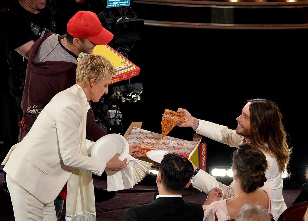 . Host Ellen DeGeneres (L) and actor Jared Leto onstage during the Oscars at the Dolby Theatre on March 2, 2014 in Hollywood, California.  (Photo by Kevin Winter/Getty Images)