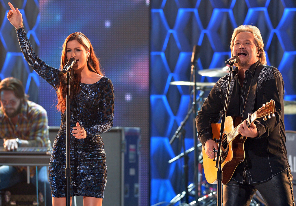 . Cassadee Pope and Travis Tritt perform on CMT Artists Of The Year 2013 at Music City Center on December 3, 2013 in Nashville, Tennessee.  (Photo by Rick Diamond/Getty Images for CMT)