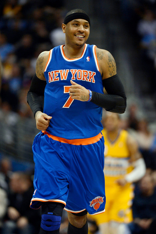 . Carmelo Anthony (7) of the New York Knicks smiles as he jogs down the court during the second quarter in their game against the Denver Nuggets March 13,  2013 at Pepsi Center. (Photo By John Leyba/The Denver Post)