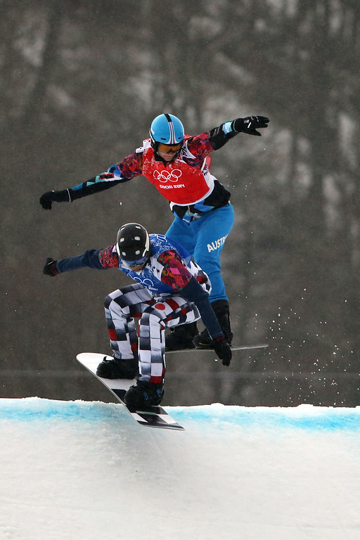 . Nikolay Olyunin (L) of Russia on his way to winning the silver medal during the Snowboarding Men\'s Snowboard Cross at the Rosa Khutor Extreme Park on February 18, 2014 in Sochi, Russia. (Photo by Christophe Pallot/Agence Zoom/Getty Images)