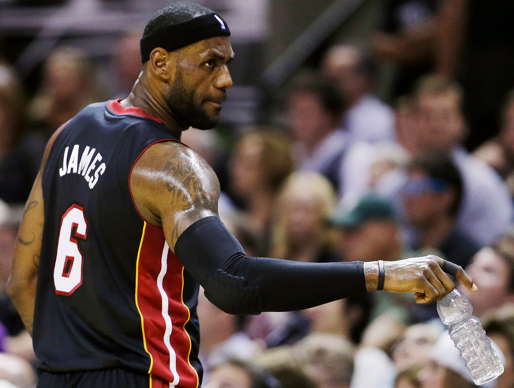 . Miami Heat forward LeBron James (6) gestures to the bench during the first half in Game 5 of the NBA basketball finals against the San Antonio Spurs on Sunday, June 15, 2014, in San Antonio. (AP Photo/David J. Phillip)