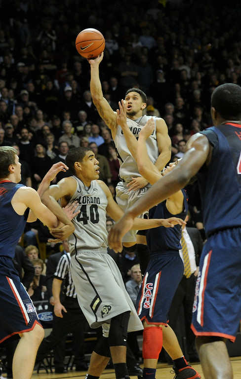 . BOULDER, CO. - FEBRUARY 14: Colorado point guard Askia Booker (0) put up a shot from outside in the second half. The University of Colorado men\'s basketball team defeated Arizona 71-58 Thursday night, February 14, 2013 at the Coors Event Center in Boulder. (Photo By Karl Gehring/The Denver Post)