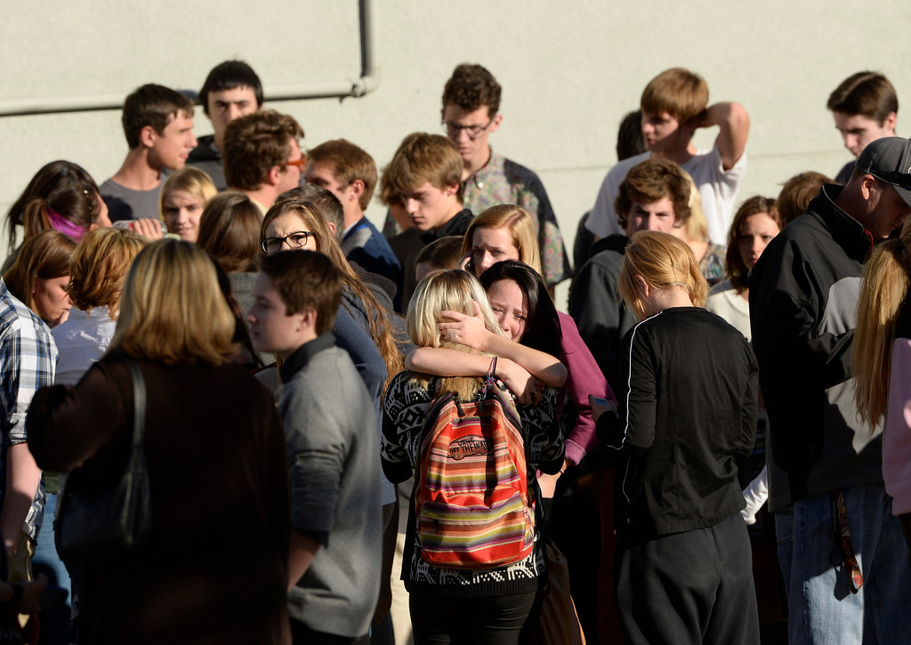 . Students gather across the street from Arapahoe High School after a shooting at the school, December 13, 2013. They would have to wait hours to be reunited with their parents. (Photo by RJ Sangosti/The Denver Post)