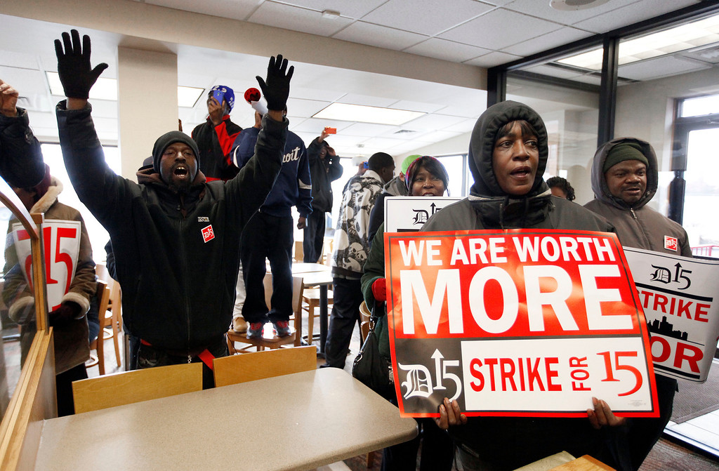 . Protesters rally for better wages at a Wendy\'s restaurant in Detroit Thursday, Dec. 5, 2013.  (AP Photo/Paul Sancya)