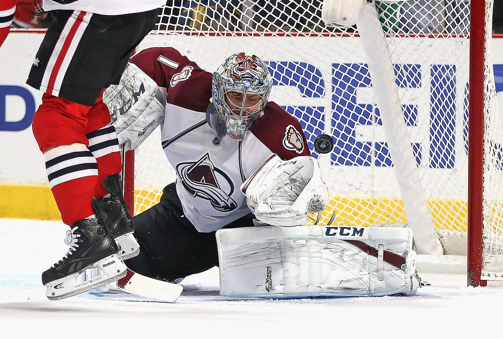 . Semyon Varlamov #1 of the Colorado Avalanche makes a save against the Chicago Blackhawks at the United Center on January 14, 2014  in Chicago, Illinois. (Photo by Jonathan Daniel/Getty Images)